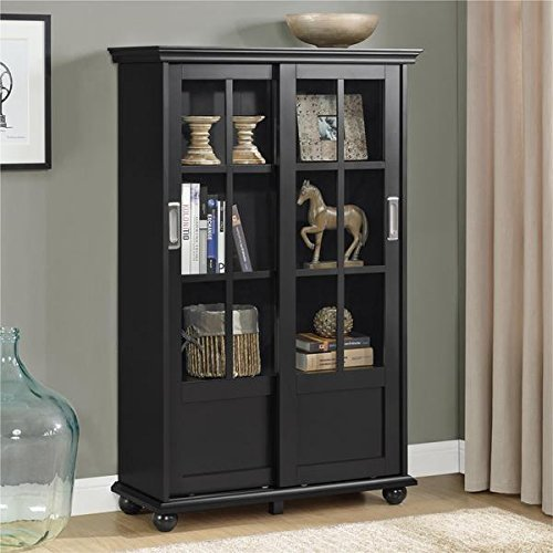 black bookcase with sliding glassdoors
